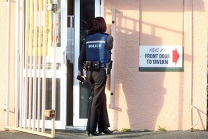Police investigate a robbery at the West End Tavern today  Photo/Ben Fraser