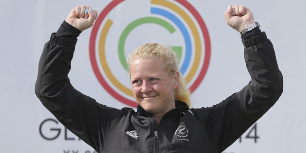 Sally Johnston of New Zealand celebrates after winning the Women's 50m Rifle Prone Shooting at Barry Buddon Shooting Centre during the Glasgow 2014 Commonwealth Games. Photo / Getty Images