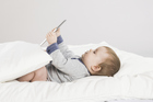 Some babies are saying 'tablet' as their first word. Photo / Thinkstock
