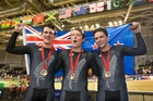 Sam Webster, Ethan Mitchell and Eddie Dawkins celebrate their cycling gold medal at the Commonwealth Games  in Glasgow. Photo / Greg Bowker