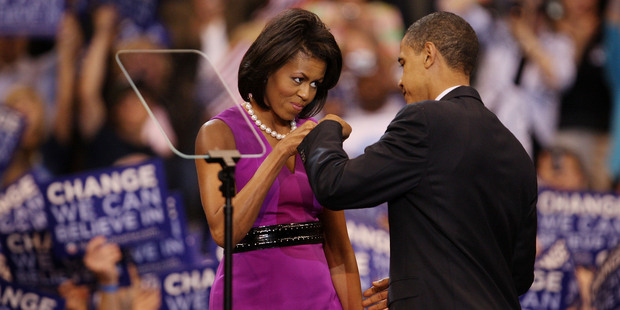 Barack Obama and his wife Michelle Obama bump fists at an election night rally in 2008. File photo / Getty Images