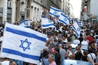 Supporters of Israel yesterday wave flags and shout slogans as they demonstrate in Marseille, France. Photo / AP