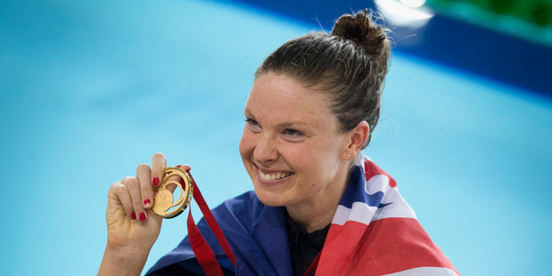 Lauren Boyle celebrates after winning gold in the women's 400m freestyle event this morning. Photo / Greg Bowker