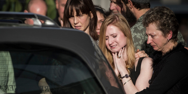 Nina is consoled by friends and family at Craig's funeral. Photo / Michael Craig