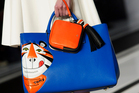 A model wears an accessory created by Anya Hindmarch during London Fashion Week Autumn/Winter 2014. Photo / AP Images.