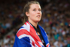 New Zealand Womens Hammer Thrower Julia Ratcliffe carries the NZ flag at Hampden Park in Glasgow. Photo / Greg Bowker