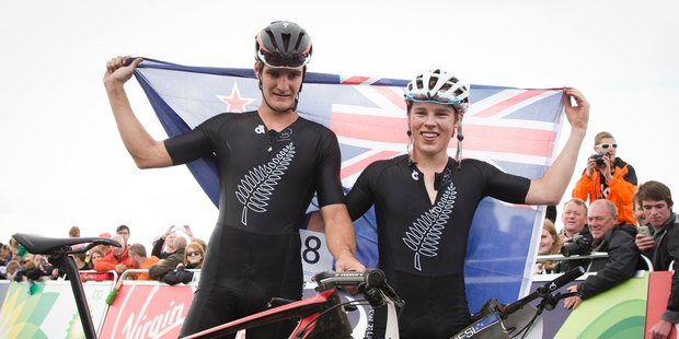 New Zealand Men's Cross Country Mountain Bikers Samuel Gaze, Silver and Anton Cooper, Gold celebrate after racing at Cathlin Braes Mountain Bike Trail at the XX Commonwealth Games. Photo/Greg Bowker.