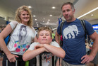 Lianne, Couper (9), and Al Killick from Christchurch, arrive in Auckland after being stuck for four days in Honolulu. Photo / Peter Meecham