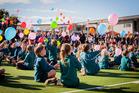 Tahatai Coast School release baloons. Photo / Andrea Mahy Photography