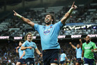 Jacques Potgieter of the Waratahs celebrates scoring a try. Photo / Getty Images