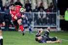 Corey Flynn of the Crusaders jumps out of a tackle during the Super Ruby Semi Final match against the Sharks. Photo / Getty Images