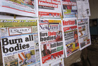 A close up of newspaper front pages focusing on the Ebola outbreak, including a newspaper, left, reading 'Burn all bodies' in the city of Monrovia, Liberia. Photo / AP
