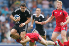 New Zealand's Bryce Heem, left, is stopped by Canada's Harry Jones during the Commonwealth Games. Photo / Getty Images
