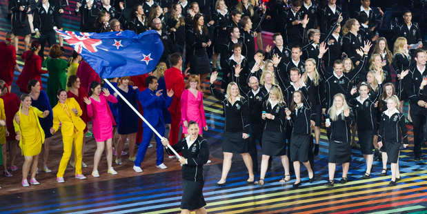 Valerie Adams, the New Zealand Flag bearer leads the New Zealand Commonwealth Games Team. Photo / Greg Bowker