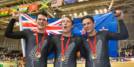 New Zealand men's sprint team of Sam Webster, Ethan Mitchell and Eddie Dawkins celebrate their gold medal. Photo Greg Bowker