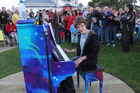 Young musician Reuben Topzand tries out the public piano at the opening of Horotutu/Our Place, a community-built park on the Paihia waterfront. PHOTO / PETER DE GRAAF