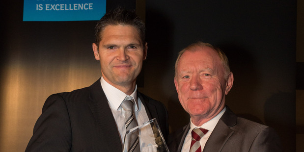 National director of industrial for Colliers International, Greg Goldfinch (left), receives the Commercial and Industrial award from Pat Houlihan of Bauer Media.
