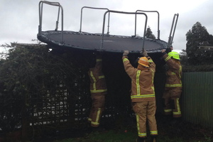 It wasn't all high drama and heroics for Northland firefighters in the recent storm. Aimee Ruka sent in this shot of Kaikohe firefighters rescuing her young son's trampoline after an unscheduled flight across her backyard and onto a neighbour's fence. The volunteers were on their way back to the station after clearing a road of one of many downed trees when they stopped by to retrieve the wayward trampoline. PHOTO / AIMEE RUKA