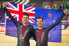 New Zealand cyclists Tom Scully, left, and Aaron Gate celebrate with their gold and bronze medals after the men's 40km points race. Photo / Greg Bowker
