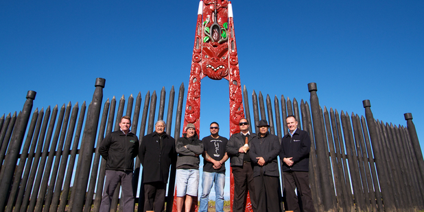 Fulton Hogan HEB Construction Alliance project director, Andrew Johnson, with kaumatua Teia Williams, carvers  Noel McAllister, Jason Puata, Joel Komene and Dean Flavell, and TEL senior project manager Wayne Troughton in front of the Waharoa work.