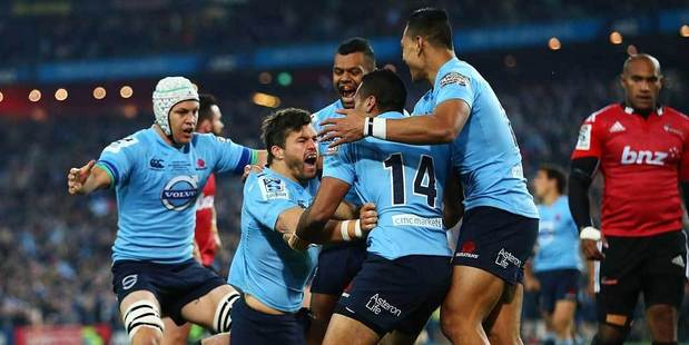 The Waratahs celebrate a try by Adam Ashley-Cooper during the Super Rugby Grand Final match between the Waratahs and the Crusaders at ANZ Stadium. Photo / Getty Images.