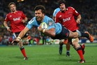 Adam Ashley-Cooper of the Waratahs scores a try during the Super Rugby Grand Final match between the Waratahs and the Crusaders. Photo / Getty Images.