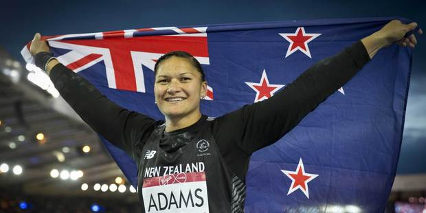 Valerie Adams celebrates after winning her third Commonwealth Games gold medal. Photo / Greg Bowker