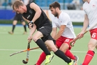 New Zealand's Blair Hilton tries to get through England's Adam Dixon and Henry Weir. Picture / Greg Bowker