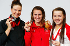 Silver medallist Lauren Boyle, left, with gold medallist Jazz Carlin of Wales and bronze medallist Brittany Maclean of Canada. Photo / Getty Images