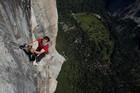 Bryan Smith climbs a rock face. Photo / Supplied