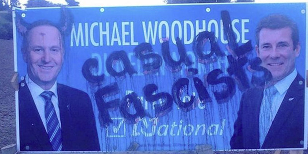 A National Party billboard featuring Dunedin North candidate Michael Woodhouse and Prime Minister John Key was defaced, and a photo later posted online. Photo / Otago Daily Times