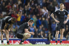New Zealand Scott Curry, middle, amongst teammates who stand dejected after losing to South Africa. Photo / Greg Bowker