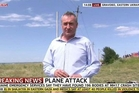 Colin Brazier, reporting from the MH17 crash site, came under fire for  rummaging through a victim's suitcase.  Picture / AP