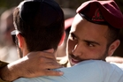 An Israeli officer comforting a friend at a funeral in Meitar, Israel. Photo / AP