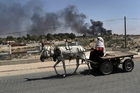 Israeli strikes in Gaza make normal life - let alone business - next to impossible for residents of the city. Picture / AP