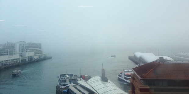 Auckland's Waitemata Harbour was a white-out this morning. Photo / supplied