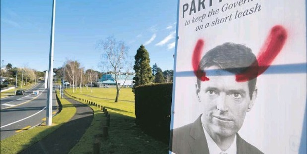 Conservative Party leader Colin Craig's image had been defaced with devil horns. Photo / George Novak