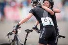 Karen Hanlen and Kute Fluker, left, embrace at the finish line of the mountain biking. Photo / Greg Bowker