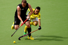 Bradley Shaw of New Zealand is challenged by Meor Hasan of Malaysia. Photo / Getty Images