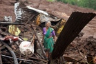 An elderly woman cries as she searches for family members in the India landslide. Photo / AP