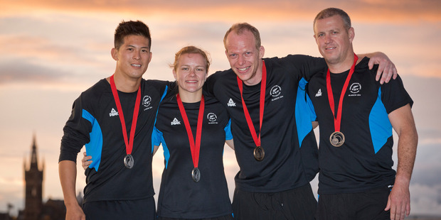 New Zealand's judo medal winners (from left to right) Adrian Leat, Moira De Villiers, Jason Koster and Tim Slyfield. Photo / Greg Bowker