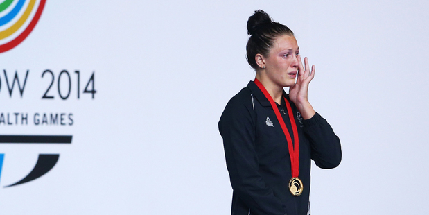 Sophie Pascoe wipes away tears during the medal ceremony after winning gold. Photo / Getty Images
