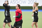 New Zealand's Liz Thompson, goalkeeper Sally Rutherford and Emily Naylor walk from the turf after losing their semifinal to England. Photo / Greg Bowker