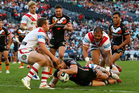 Robbie Farah of the Tigers scores during the round 20 NRL match against the St George Illawarra Dragons. Photo / Getty Images