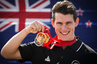 New Zealand track cyclist Sam Webster poses with his three medals. Photo / Greg Bowker