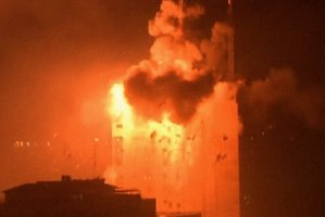 An explosion hits a media complex in central Gaza City. Photo / AP