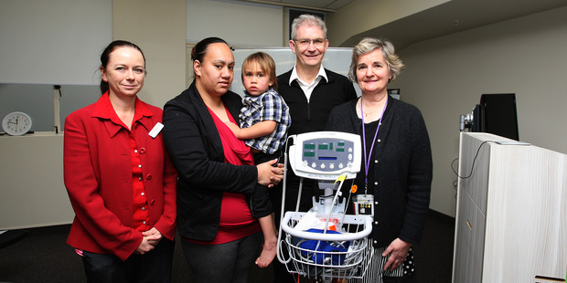 Charlie Tangira with her son Wiremu le Comte, 3, and Countdown store manager Tanya Lawrence and Tauranga Hospital's BOPDHB medical director Dr Hugh Lees and paediatrician Dr Roslyn Selby.