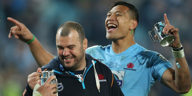 Waratahs coach Michael Cheika and Israel Folau celebrate victory in the Super Rugby Grand Final. Photo / Getty Images