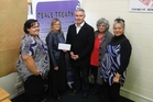 Kelvin Davis pictured with Whangarei Rape Crisis workers and volunteers.