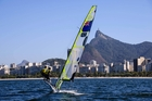 Peter Burling and Blair Tuke on their way to gold at the test regarra in Rio yesterday. Photo / Alex Ferro